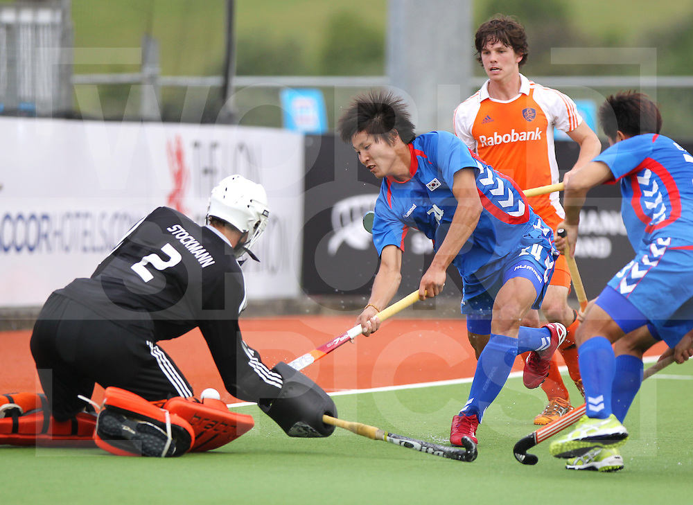 Mens Champions Trophy, Auckland, New Zealand 2011. Day 1 Netherlands v Korea.Jeon Byung Jin for Korea..Photo: Grant Treeby.one off Editorial Use only,( no archiving )......................Photo: Grant Treeby...Editorial use only (No Archiving) Unless previously arranged