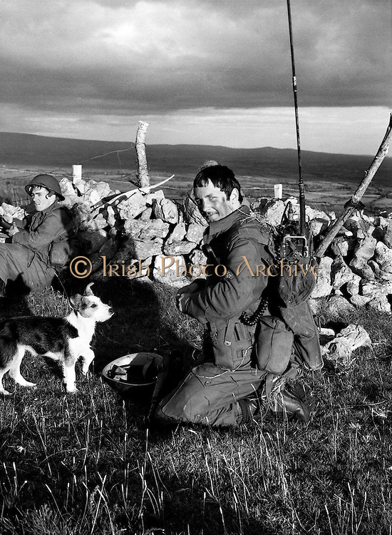 Members of the Irish Army on  exercise in Co Sligo are joined by an unusual new recruit.<br /> 07/09/1977