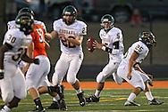 Kennedy's Derek Jacobus (5) looks for an open receiver during their game at John Wall Memorial Stadium at Prairie High School in Cedar Rapids on Friday, September 6, 2013.