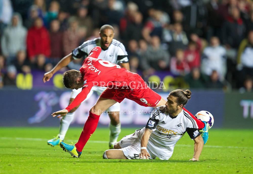 SWANSEA, WALES - Monday, September 16, 2013: Liverpool's Iago Aspas is tackled by Swansea City's Chico Flores during the Premiership match at the Liberty Stadium. (Pic by David Rawcliffe/Propaganda)