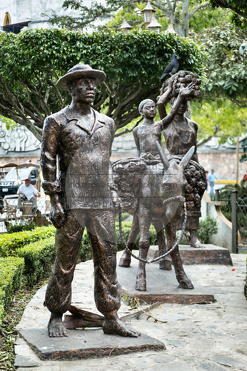 Statue honoring the indigenous Totonac people in the Plaza Central Israel Tellez Park in Papantla, Veracruz, Mexico.