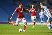 Bristol City midfielder Elliott Bennett (13) shoots at goal during the Sky Bet Championship match between Brighton and Hove Albion and Bristol City at the American Express Community Stadium, Brighton and Hove, England on 20 October 2015. Photo by Phil Duncan.