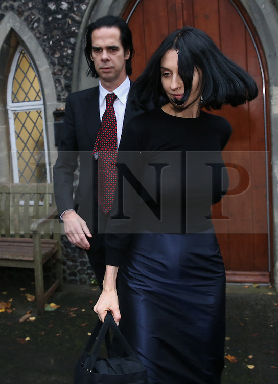 © Licensed to London News Pictures. 10/11/2015. Brighton, UK. Susie Bick leaves Brighton Coroner's Court with her husband musician Nick Cave after attending an inquest into the death of their son. 15 year old Arthur Cave, the son of musician Nick Cave, died as the result of a fall from cliffs in Brighton in July 2015. Photo credit: Peter Macdiarmid/LNP