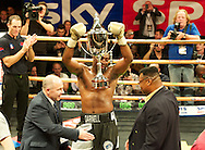 Picture by Alan Stanford/Focus Images Ltd +44 7915 056117<br /> 14/11/2013<br /> Michael Sprott wins on points during their heavyweight prize fighter final  contest and is presented with the trophy by former champion Larry Holm at York Hall, Bethnal Green.