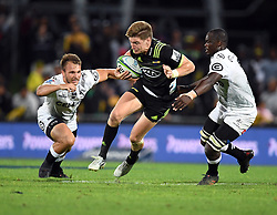Hurricanes Jordie Barrett splits the Sharks defence in the Super Rugby match at McLean Park, Napier, New Zealand, Friday, April 06, 2018. Credit:SNPA / Ross Setford