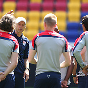 Head Coach Jurgen Klinsmann, (facing), talks to the team during the New York Red Bulls Vs Portland Timbers, Major League Soccer regular season match at Red Bull Arena, Harrison, New Jersey. USA. 24th May 2014. Photo Tim Clayton