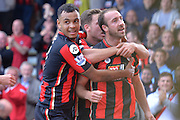 AFC Bournemouth's striker Glenn Murray (right) celebrates with AFC Bournemouth's striker Joshua King during the Barclays Premier League match between Bournemouth and Watford at the Goldsands Stadium, Bournemouth, England on 3 October 2015. Photo by Mark Davies.