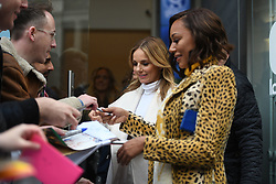 Spice Girls Geri Horner and Melanie Brown sign autographs as they leave Global Radio studios in Leicester Square, London.