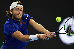 BEIJING, Oct. 3, 2017  Lucas Pouille of France returns the ball during the men's singles first round match against Rafael Nadal of Spain at 2017 China Open tennis tournament in Beijing, capital of China, Oct. 3, 2017. Nadal won 2-1. (Credit Image: © Ju Huanzong/Xinhua via ZUMA Wire)