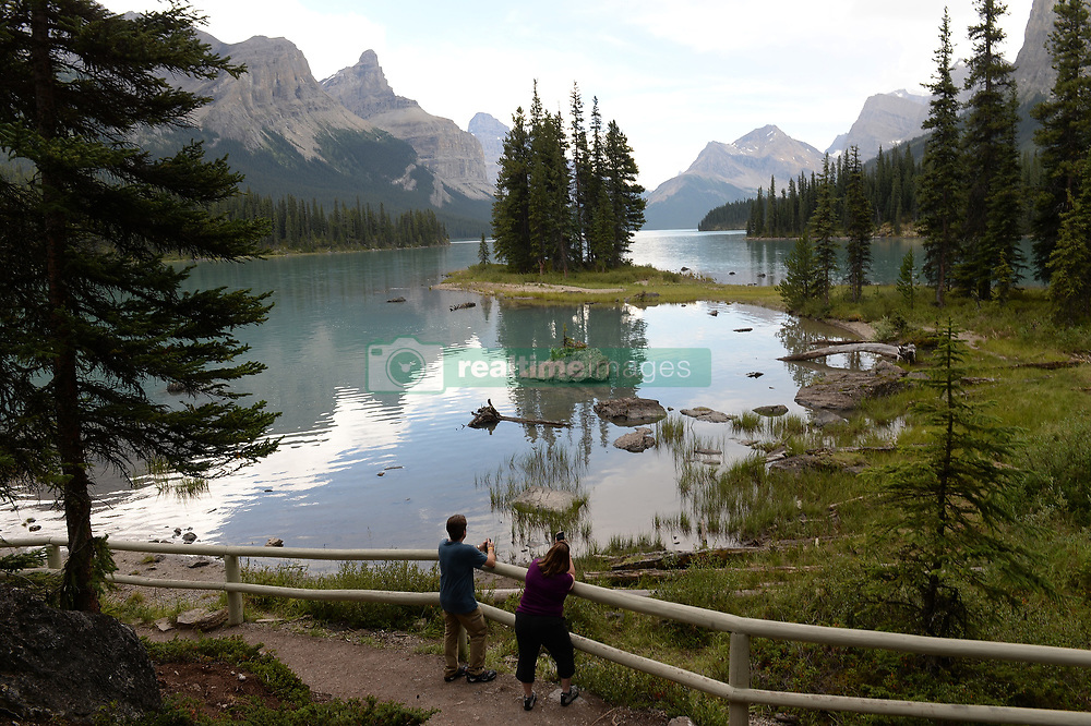 These are some of the sights and activities Prince Harry and Meghan Markle may partake in if they decide to honeymoon in the gorgeous area of Jasper, Alberta, Canada. The famous Canadian Rockies offer the natural beauty of glacier fed lakes like Lake Maligne, Lake Louise, and Lake Moraine. Visitors often like to take hikes to waterfalls or take a canoe ride around a lake. While hiking, it is common to see wildlife like bears, moose, elk, and much more. The more adventurous traveler can try horseback riding, fishing, or even rock climbing! There is no end to the natural beauty that can be found in the area, and beautiful sunsets give way to star-filled skies, which would make for a perfectly romantic royal honeymoon. 30 May 2018 Pictured: Spirit Island on Lake Maligne. Photo credit: MEGA TheMegaAgency.com +1 888 505 6342