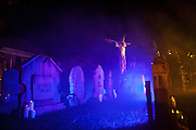 "Fog lifts up over Chris Baker's haunted yard in South Yarmouth, MA. Every year Baker sets up an elaborate Halloween display in his yard and on Halloween, neighborohood residents walk through his frightening ""vortex"" of horror while trick or treating."