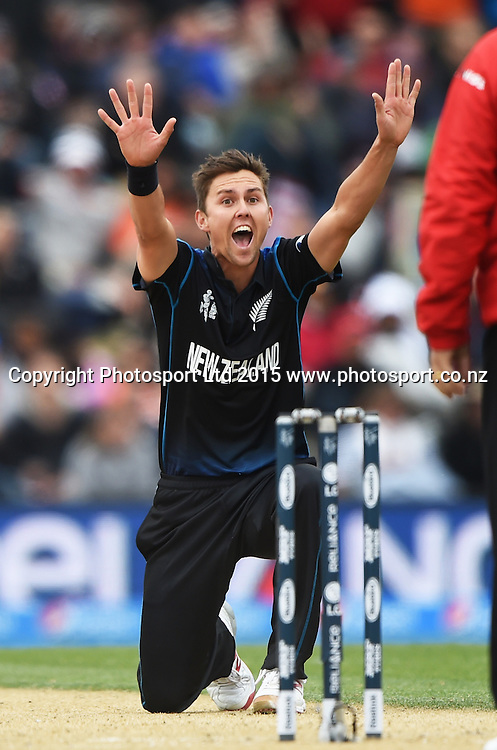 Trent Boult appeals successfully for a LBW decision to dismiss Kumar Sangakkara during the ICC Cricket World Cup match between New Zealand and Sri Lanka at Hagley Oval in Christchurch, New Zealand. Saturday 14 February 2015. Copyright Photo: Andrew Cornaga / www.Photosport.co.nz