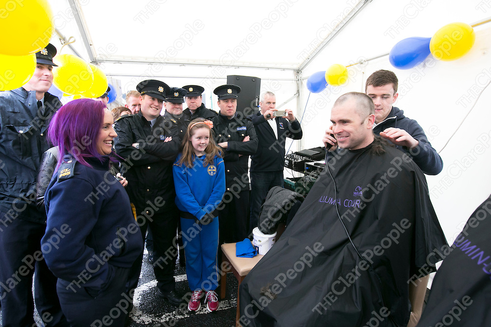 Garda Deirdre O'Doherty looks on with other Colleagues as Garda Frank Browne &amp; Superintendent John Kerin pictured before getting their Heads Shaved at  the Garda Shave or Dye event in O'Connell Square Ennis. .<br /> Pictured Credit Brian Gavin Press 22