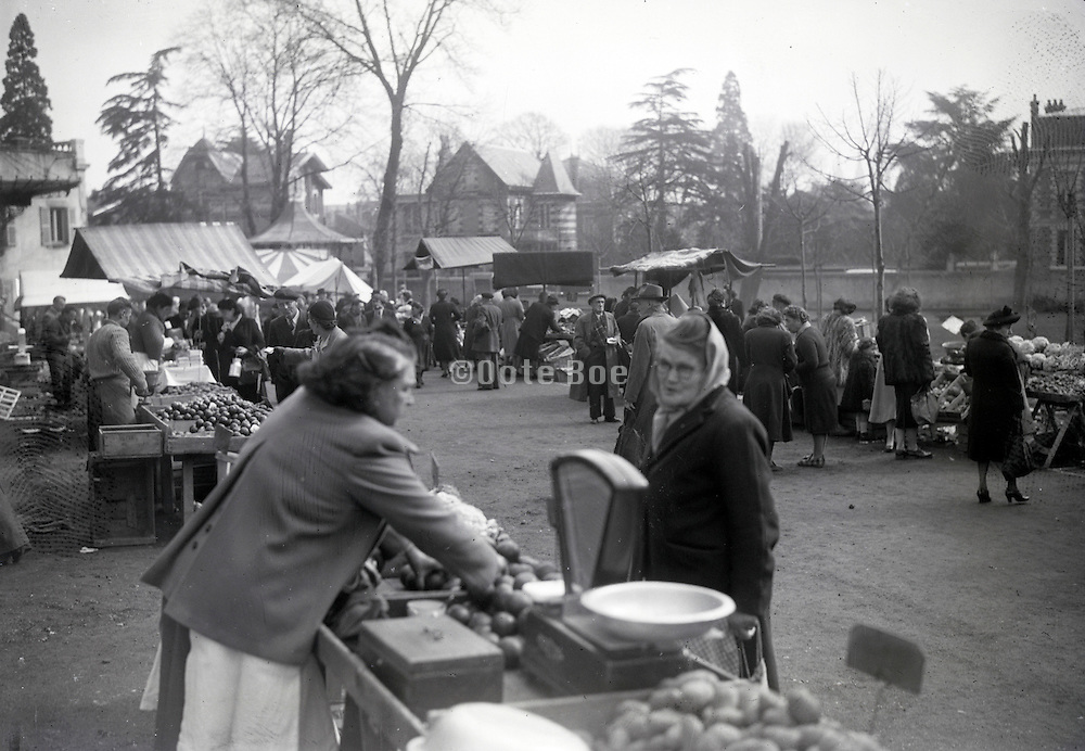 outdoor farmers market day in French village 1940s
