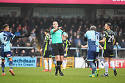 Referee Carl Boyeson speaks with Wycombe Wanderers Forward Adebayo Akinfenwa (20) during the EFL Sky Bet League 2 match between Wycombe Wanderers and Carlisle United at Adams Park, High Wycombe, England on 3 February 2018. Picture by Stephen Wright.