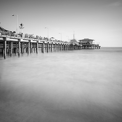 Santa Monica Pier black and white photo. Santa Monica is a coastal beach city along the Pacific Ocean in Los Angeles County California. Photo is high resolution. Copyright ⓒ 2017 Paul Velgos with All Rights Reserved.
