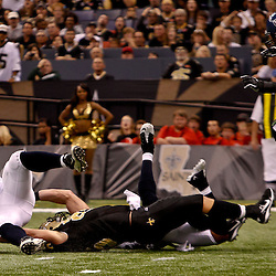 November 21, 2010; New Orleans, LA, USA; Seattle Seahawks linebacker David Hawthorne (57) is tackled by New Orleans Saints tight end David Thomas (85) after intercepting a pass during the second half at the Louisiana Superdome. The Saints defeated the Seahawks 34-19. Mandatory Credit: Derick E. Hingle