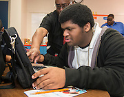 Students get assistance with their new laptops at Kashmere High School, January 14, 2014.