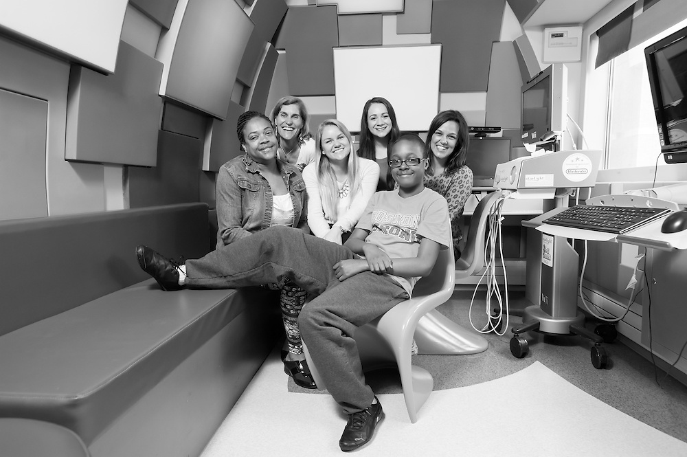 A young boy with his mother, nurses, and doctors photographed for Flashes of Hope at the Children's Floating Hospital in Boston, MA.
