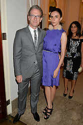 ASHLEY HICKS and his wife KATA DE SOLLIS at a party to kick off London Fashion Week hosted by US Ambassador Matthew Barzun and Mrs Brooke Brown Barzun with Alexandra Shulman in association with J.Crew hrld at Winfield House, Regent's Park, London on 18th September 2015.