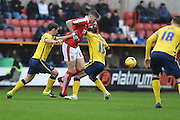 Swindon Town's Ben Gladwin breaks through the tacklers during the Sky Bet League 1 match between Swindon Town and Scunthorpe United at the County Ground, Swindon, England on 14 November 2015. Photo by Mark Davies.