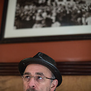 "Actor Richard Schiff, famous for his role as ""Toby"" on the West Wing, during an interview at District Chop House and Brewery in Washington, DC, March 1, 2013. A picture of the White House hangs on the wall behind."