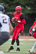 Community College of San Francisco quarterback Lavell McCullers (5) looks for an open receiver against College of Siskiyous at Community College of San Francisco in San Francisco, Calif., on September 10, 2016. (Stan Olszewski/Special to S.F. Examiner)