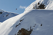 Rusty Ockenden does a frontside 1080 first try in to a fresh powder landing on the 'Birthday Jump' in the Callaghan backcountry on a bluebird day