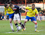 Greenock Morton's Martin Hardie and Craig Reid try to stop Dundee's John Baird - Dundee v Greenock Morton, William Hill Scottish Cup 5th Round at Dens Park .. - © David Young - www.davidyoungphoto.co.uk - email: davidyoungphoto@gmail.com