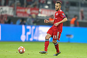 Bayern Munich defender Rafinha (13) passes the ball during the Champions League match between Bayern Munich and Liverpool at the Allianz Arena, Munich, Germany, on 13 March 2019.