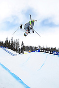 SHOT 1/12/13 11:10:32 AM - French skier Kevin Rolland gets inverted high above the pipe during the men's Ski Halfpipe finals at the U.S. Snowboarding and Freeskiing Grand Prix at Copper Mountain, Co. Rolland finished 8th in the event with a score of 68.8. (Photo by Marc Piscotty / © 2013)