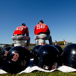February 23, 2011; Fort Myers, FL, USA; Boston Red Sox starting pitcher Tim Wakefield (49) and relief pitcher Jonathan Papelbon (58) take a break between drills during spring training at the Player Development Complex.  Mandatory Credit: Derick E. Hingle-US PRESSWIRE