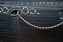 Anchor port of the L.A. Dunton, Mystic Seaport, The Museum of America and the Sea, is the leading maritime museum in the United States.  A coastal New England village is recreated with wooden ships, a ship yard, and several businesses - Mystic, Connecticut.