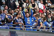 AFC Wimbledon defender Callum Kennedy (3) lifting the trophy during the Sky Bet League 2 play off final match between AFC Wimbledon and Plymouth Argyle at Wembley Stadium, London, England on 30 May 2016.