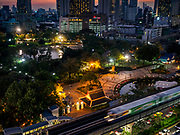 08 MARCH 2019 - BANGKOK, THAILAND: A BTS Skytrain goes out of Bangkok on the Sukhumvit Line at sunset.    PHOTO BY JACK KURTZ