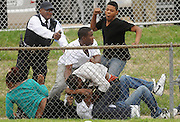 ANDREW JANSEN / JOURNAL<br /> Spectators at a high school football game between Miller Career Academy and Gateway Tech at Gateway Technical School get into a fight as security and Police attempt to break it up.
