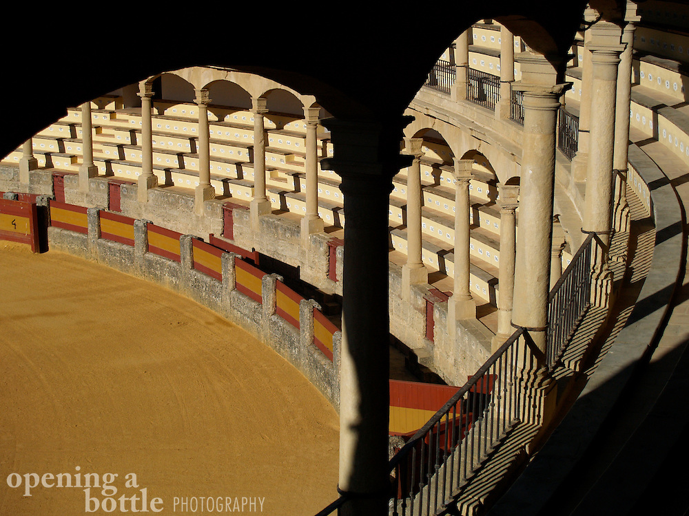 The arcades of the grandstands in late evening, Ronda Bullring, Ronda (Andalusia), Spain. It is said that this bullring is the birthplace of modern bull fighting.
