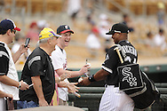 GLENDALE, AZ - MARCH 05:  Dayan Viciedo #24 of the Chicago White Sox signs autographs prior to the game against the Los Angeles Dodgers on March 5, 2012 at The Ballpark at Camelback Ranch in Glendale, Arizona. The Dodgers defeated the White Sox 6-4.  (Photo by Ron Vesely)  Subject:  Dayan Viciedo