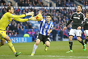 Brentford goalkeeper David Button gets to the ball ahead of Sheffield Wednesday striker Fernando Forestieri  during the Sky Bet Championship match between Sheffield Wednesday and Brentford at Hillsborough, Sheffield, England on 13 February 2016. Photo by Simon Davies.