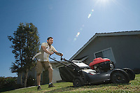 Man moving lawn low angle