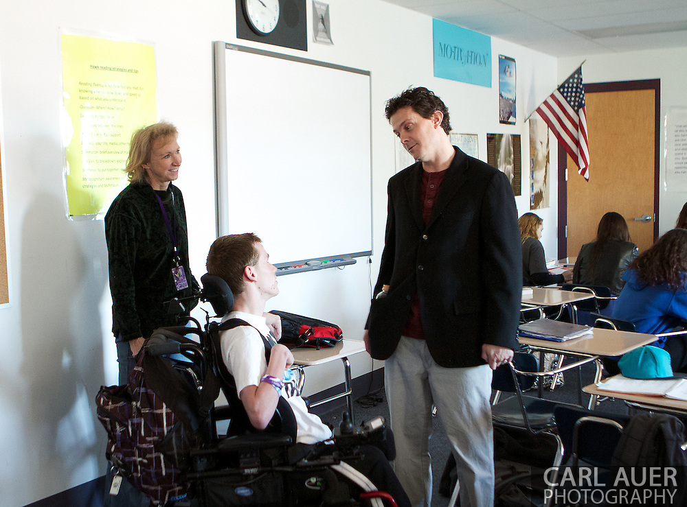 Mr. Casey Hawk speaks to AJ Novotny during his English class.