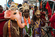 Led by a brass band, and the Gods Ganesh and Shakthi, a group of pilgrims in their way to Melmaruvathur Temple which is south of the City.