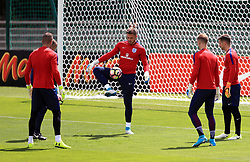 England goalkeeper Jack Butland (centre) with fellow keepers including Joe Hart, Tom Heaton and Fraser Forster during the training session at Stade Omnisport.