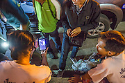 "10 NOVEMBER 2012 - BANGKOK, THAILAND:  Medics from the Ruamkatanya Foundation review video of a fatal accident they worked in Bangkok during their informal debrief.  The Ruamkatanyu Foundation was started more than 60 years ago as a charitable organisation that collected the dead and transported them to the nearest facility. Crews sometimes found that the person they had been called to collect wasn't dead, and they were called upon to provide emergency medical care. That's how the foundation medical and rescue service was started. The foundation has 7,000 volunteers nationwide and along with the larger Poh Teck Tung Foundation, is one of the two largest rescue services in the country. The volunteer crews were once dubbed Bangkok's ""Body Snatchers"" but they do much more than that now.    PHOTO BY JACK KURTZ"