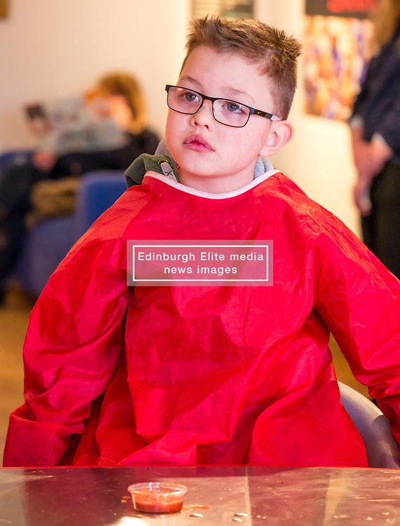 City Arts Centre, Edinburgh, Scotland, United Kingdom, 9 April 2019. Edinburgh Science Festival:  Jamie Carter, age 8 years, has fun learning about blood at the Blood Bar drop in event at the Science Festival. <br /> <br /> Sally Anderson   EdinburghElitemedia.co.uk