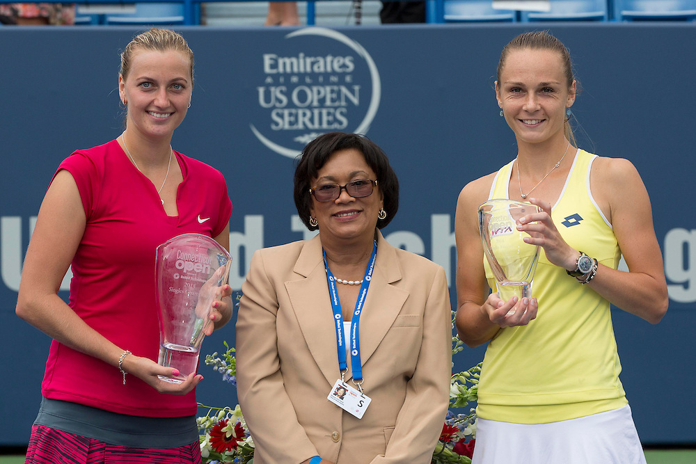 August 23, 2014, New Haven, CT:<br /> New Haven Mayor Toni Harp poses for a photograph with champion Petra Kvitova and finalist Magdalena Rybarikova during a ceremony following the Singles Final on day nine of the 2014 Connecticut Open at the Yale University Tennis Center in New Haven, Connecticut Saturday, August 23, 2014.<br /> (Photo by Billie Weiss/Connecticut Open)