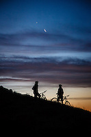 Mike Montgomery and Chris Akrigg get in a sunrise bike ride, Deer Valley, Utah.