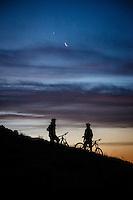 Mike Montgomery and Chris Akrigg get in a sunrise bike ride, Deer Valley, Utah.