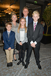 RUPERT & SARAH HESELTINE with their children, left to right, ARCHIE HESELTINE, HERMIONE HESELTINE and WILL HESELTINE at a party to celebrate the publication of Thenford: The Creation of an English Garden by Michael & Anne Heseltine held at The Grosvenor House Hotel, Park Lane, London on 24th October 2016.