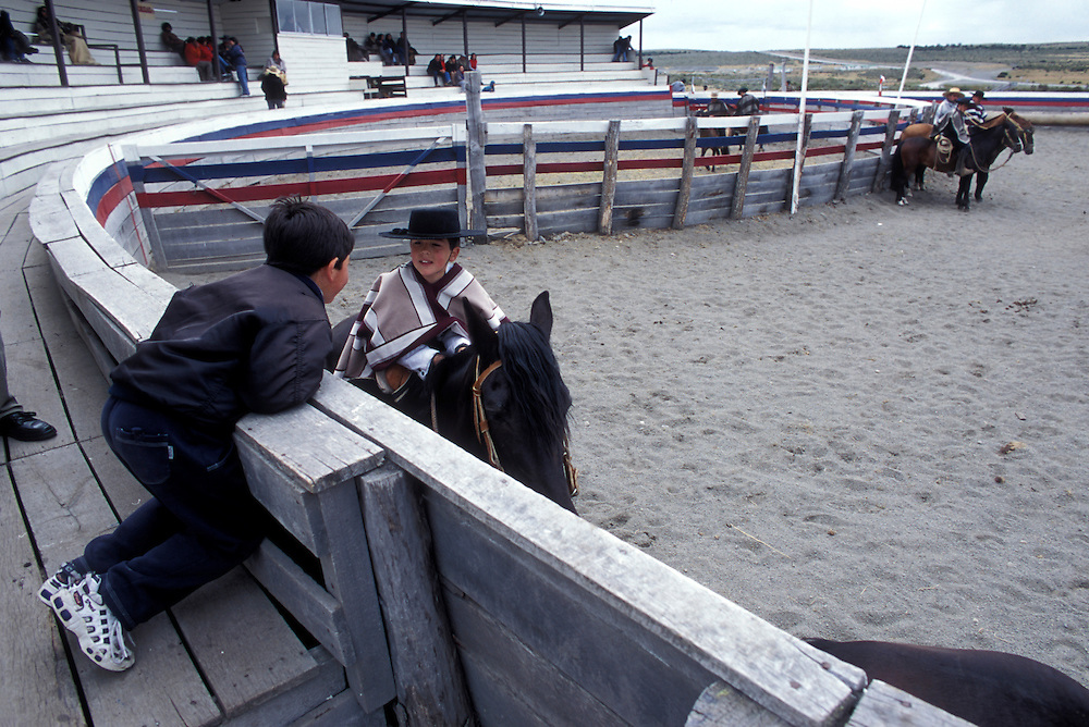 Chile, Young Chilean Cowboy known as a Huaso in arena during traditional rodeo in Villa Tehuelches in southern Patagonia